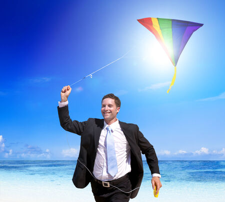 Businessman relaxing on a tropical beach. photo