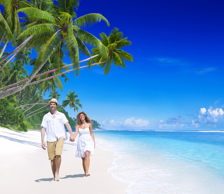 Couple relaxing on the beach. Stock Photo