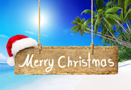tropical christmas: Christmas board on the beach. Stock Photo