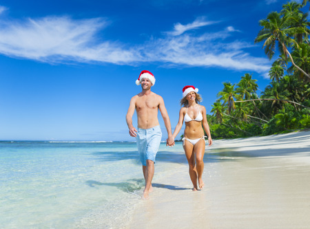 bikini couple: A couple relaxing on the beach on Christmas.