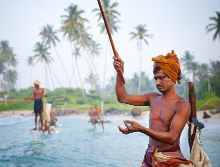 sri lanka: Traditional stilt fishermen in Sri Lanka.