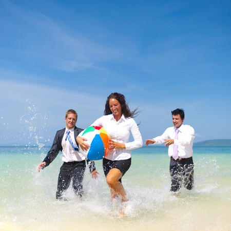 Business people having fun on vacation. photo