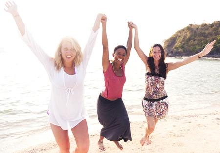 Carefree women enjoying the beach. Banco de Imagens - 31336838