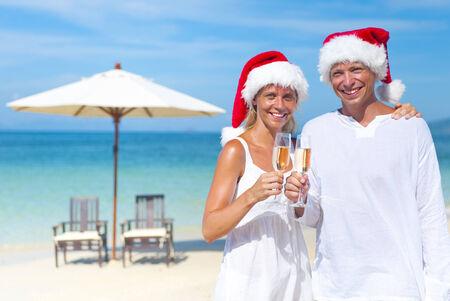 A couple celebrating on the beach. photo