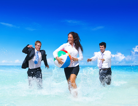 business suit: Business people having fun on vacation.