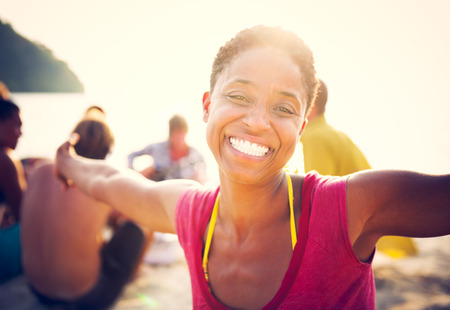 smiling woman: Group of people party on the beach.