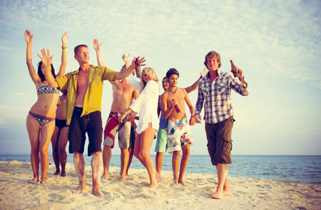 Group of people party on the beach.