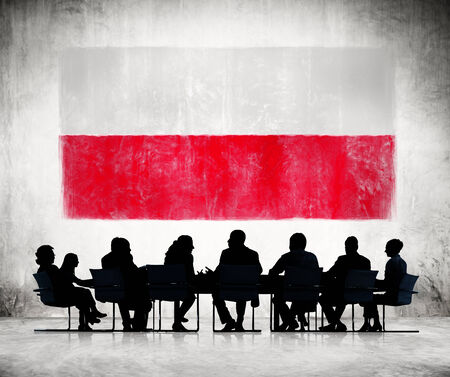 polish flag: Business People in a Meeting with Polish Flag