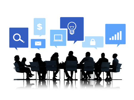 Sihouettes of Business People in a Meeting with Business Symbols Фото со стока - 34537000