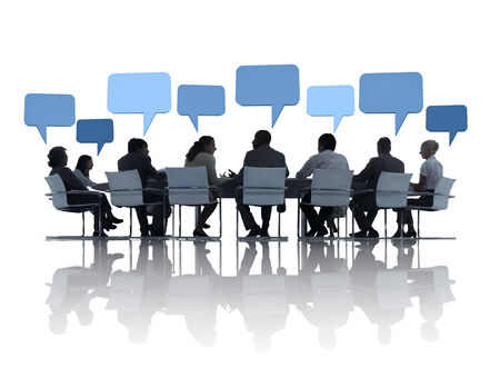board room: Business People Discussing Around The Conference Table And Speech Bubbles Above Them.