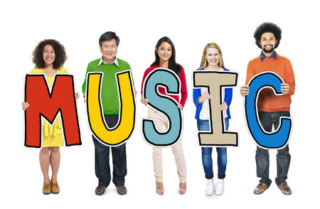 Group of People Standing Holding Music Letter photo