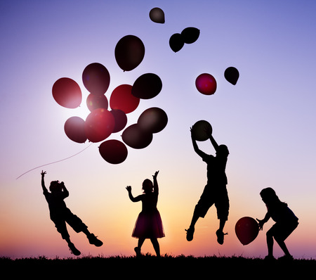 Children Outdoors Playing with Balloons photo