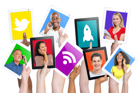 telecommunications equipment: Diverse Hands Holding Digital Tablets and Social Media Icons