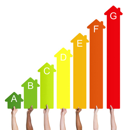 Multi-ethnic people holding house energy graph. Imagens - 34537365