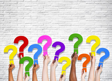 to mark: Multi-Ethnic group of human hands holding question marks. Stock Photo