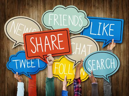 Hands Holding Speech Bubbles with Social Media Words Foto de archivo