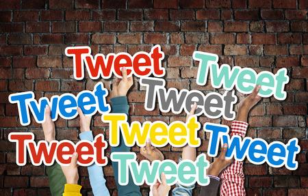 tweet: Diverse Hands Holding the Word Tweet