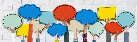 social gathering: Group of Hands Holding Speech Bubbles Stock Photo