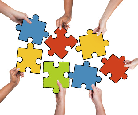 colorful: Group of Hands Holding Jigssaw Puzzle