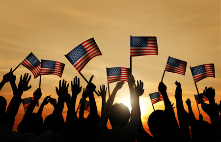 united people: Group of People Waving Armenian Flags in Back Lit Stock Photo