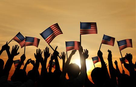 banderas america: Grupo de personas que ondeaban banderas de Armenia en Contraluz Foto de archivo