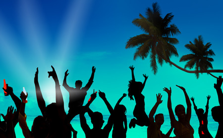 Silhouettes of Young People Celebrating on a Beach photo