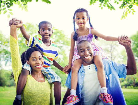 of african descent: Family Bonding Happiness Togetherness Park Concept Stock Photo