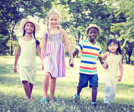 diversity children: Diverse Children Friendship Playing Outdoors Concept Stock Photo