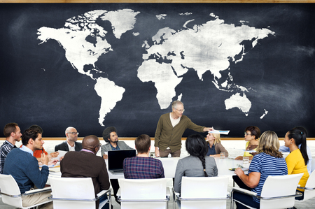 world map: Group of People in a Meeting and World Map Stock Photo