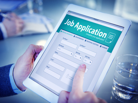 place of employment: Hands Holding Digital Tablet Job Application