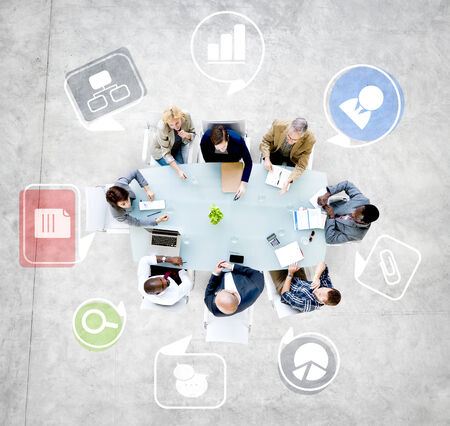 coordinating: Group of Diverse Business People Discussing in a Meeting Stock Photo