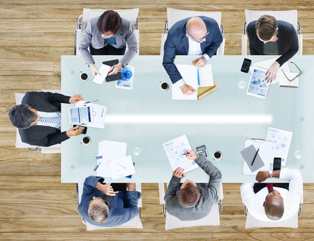 white collar worker: Business People Having a Meeting in the Office Stock Photo