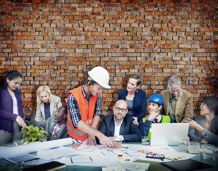 construction worker: Business People and Architects in a Meeting