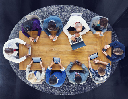 network concept: Group of Business People Using Digital Devices Stock Photo