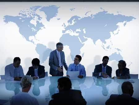 meeting table: Business People Having a Discussion and World Map