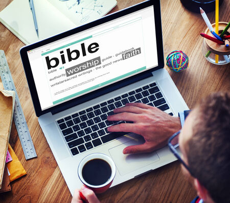 guide book: Man Reading the Definition of Bible