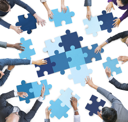 Aerial View of Business People Piecing Puzzle Pieces Stockfoto