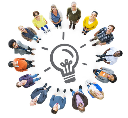 Multiethnic People Looking Up with Light Bulb Symbol Stock Photo