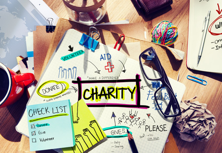 Multicolored Charity Concept Desk with Notes Stock Photo