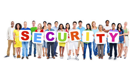 Multi-Ethnic Group Of People Holding Alphabet To Form Security photo