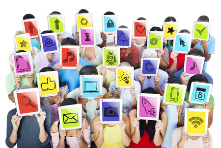 Unity of multi-ethnic people holding ipads with social networking themed images in it. photo