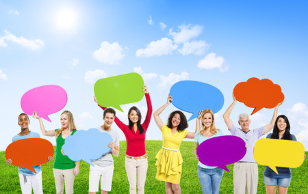 Group of Diverse Multi-Ethnic People Outdoors Holding Colorful Speech Bubbles Stock Photo - 34542152