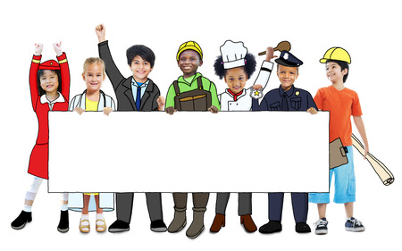 Group of Children in Dreams Job Uniform Holding Banner with Copy Space Stock Photo