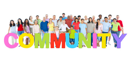 Multi-ethnic group of people holding COMMUNITY letters Imagens