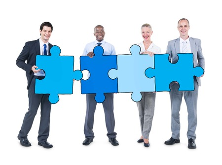 Group of Business People Holding Puzzle Pieces photo