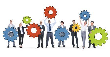 business equipment: Business People Holding Gear Symbols