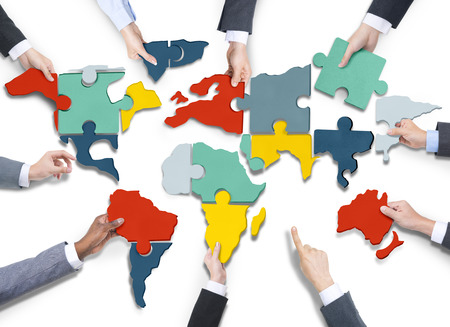 global strategy: Diverse Business Peoples Hands with Cartography Puzzle
