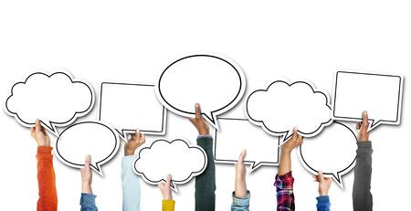 Group of Hands Holding Speech Bubbles Standard-Bild
