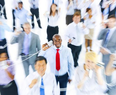 Business People Communicating Via Tin Can Phone Standard-Bild