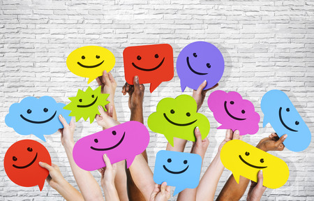 smiley faces: Hands holding smiley faces icons. Stock Photo